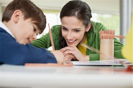 studying (all students) - Woman teaching her son at home Stock Photo - Premium Royalty-Free, Code: 6108-06167582
