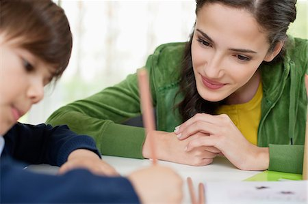 Woman teaching her son at home Stock Photo - Premium Royalty-Free, Code: 6108-06167594