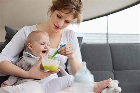 Woman feeding her daughter Stock Photo - Premium Royalty-Free, Code: 6108-06167752