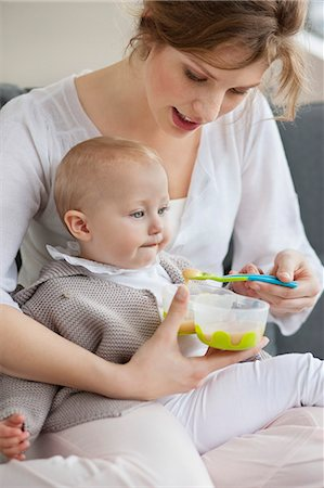 Woman feeding her daughter Stock Photo - Premium Royalty-Free, Code: 6108-06167757