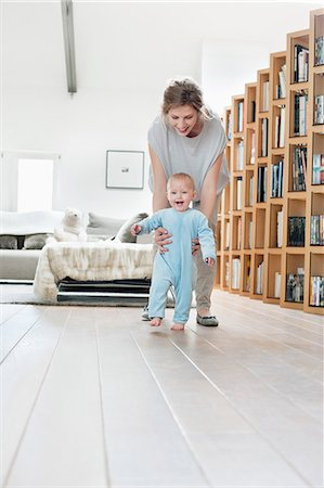 floor - Woman playing with her daughter Stock Photo - Premium Royalty-Free, Code: 6108-06167759