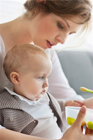 Woman feeding her daughter Stock Photo - Premium Royalty-Free, Code: 6108-06167769