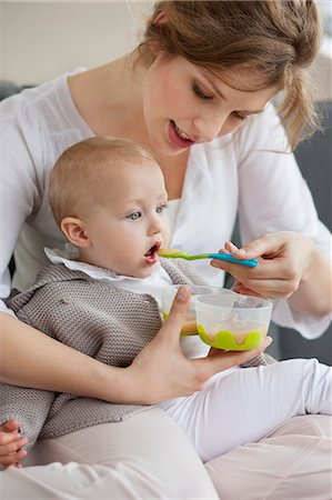Woman feeding her daughter Stock Photo - Premium Royalty-Free, Code: 6108-06167712