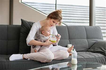 Woman feeding her daughter Stock Photo - Premium Royalty-Free, Code: 6108-06167717