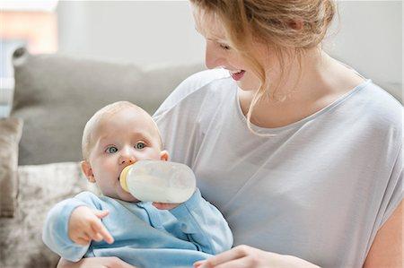 Baby girl feeding on milk with a milk bottle Stock Photo - Premium Royalty-Free, Code: 6108-06167715