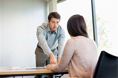 Business executive discussing with his client Stock Photo - Premium Royalty-Free, Code: 6108-06167943
