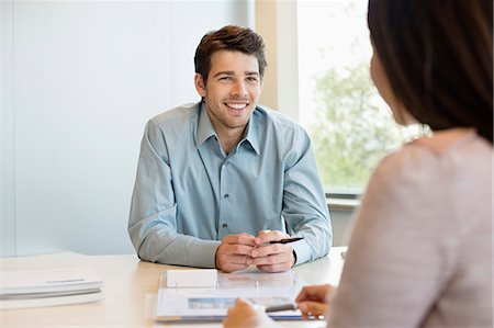 Business executive discussing with his client Stock Photo - Premium Royalty-Free, Code: 6108-06167954