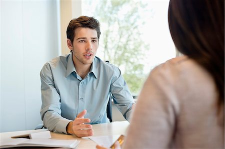 Business executive discussing with his client Stock Photo - Premium Royalty-Free, Code: 6108-06167964