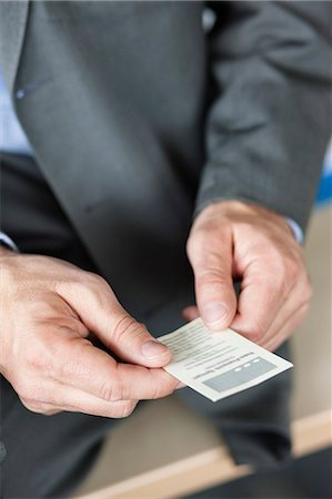 Close-up of a businessman holding a business card Stock Photo - Premium Royalty-Free, Code: 6108-06167981