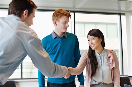 Business executive shaking hands with his clients Stock Photo - Premium Royalty-Free, Code: 6108-06167907