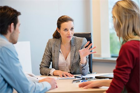 Business executive discussing with her clients Stock Photo - Premium Royalty-Free, Code: 6108-06167905
