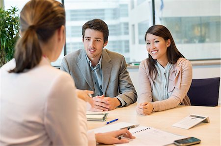 Business executive discussing with her clients Stock Photo - Premium Royalty-Free, Code: 6108-06167908