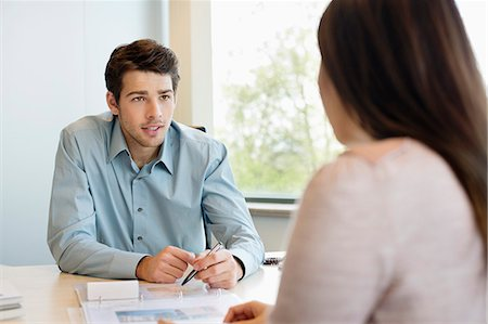 Business executive discussing with his client Stock Photo - Premium Royalty-Free, Code: 6108-06167911