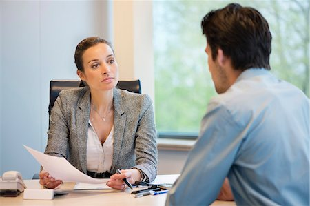 Business executive discussing with her client Stock Photo - Premium Royalty-Free, Code: 6108-06167914