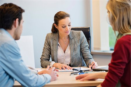 Business executive discussing with her clients Stock Photo - Premium Royalty-Free, Code: 6108-06167919