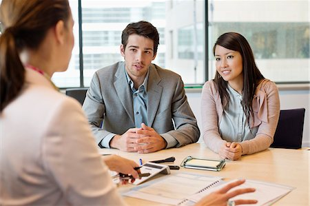Business executive discussing with her clients Stock Photo - Premium Royalty-Free, Code: 6108-06167923