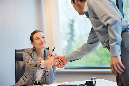 Business executive shaking hands with her client Stock Photo - Premium Royalty-Free, Code: 6108-06167920