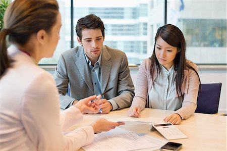 Business executive discussing with her clients Stock Photo - Premium Royalty-Free, Code: 6108-06167921