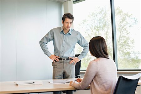 Business executive discussing with his client Stock Photo - Premium Royalty-Free, Code: 6108-06167925