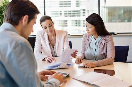 Business executive discussing property documents to his clients Stock Photo - Premium Royalty-Free, Code: 6108-06167928