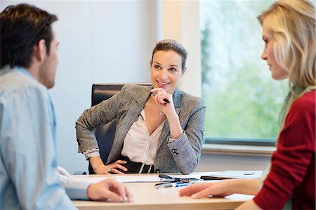Business executive discussing with her clients Stock Photo - Premium Royalty-Free, Code: 6108-06167929