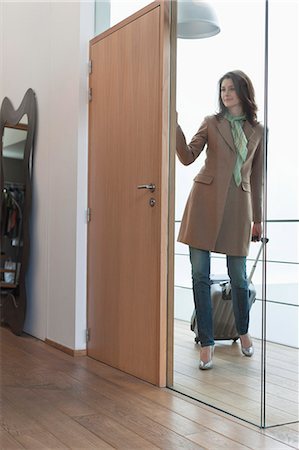 Woman arriving at home from vacations Stock Photo - Premium Royalty-Free, Code: 6108-06168084