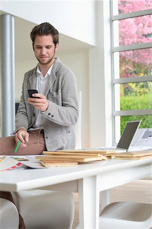 drawing computer - Interior designer using a mobile phone in the office Stock Photo - Premium Royalty-Free, Code: 6108-06168141