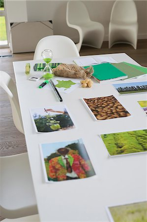 poster - Ecology sustainable development related photographs on a table Stock Photo - Premium Royalty-Free, Code: 6108-06168114