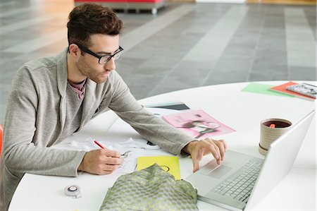 drawing computer - Male fashion designer working in an office Stock Photo - Premium Royalty-Free, Code: 6108-06168246