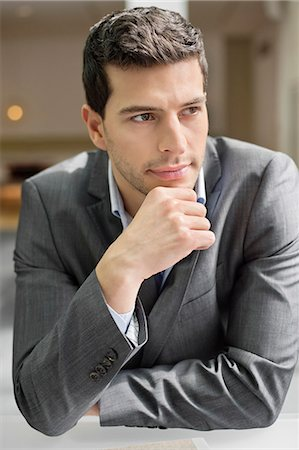 Close-up of a businessman thinking Stock Photo - Premium Royalty-Free, Code: 6108-06168306