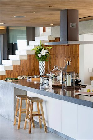Interiors of a kitchen counter in a studio apartment Stock Photo - Premium Royalty-Free, Code: 6108-06904353