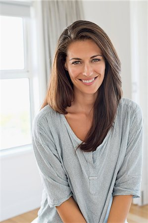Portrait of a woman smiling Stock Photo - Premium Royalty-Free, Code: 6108-06904467