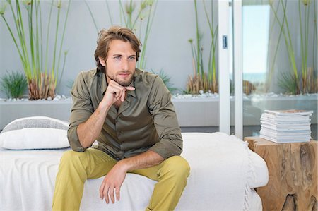 property release - Man sitting at home and thinking Stock Photo - Premium Royalty-Free, Code: 6108-06904540