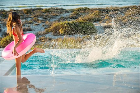 splash - Woman enjoying in a swimming pool on the beach Stock Photo - Premium Royalty-Free, Code: 6108-06904641