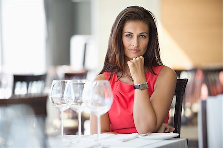 female - Woman sitting in a restaurant and thinking Stock Photo - Premium Royalty-Free, Code: 6108-06904760