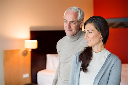 Couple smiling in a hotel room Stock Photo - Premium Royalty-Free, Code: 6108-06905032