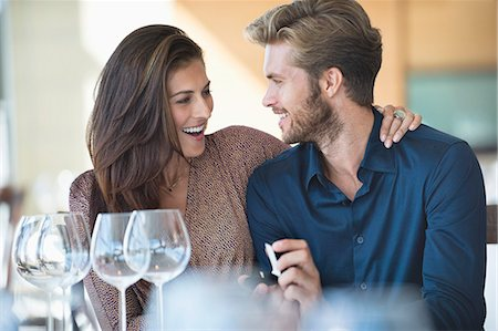 Man with engagement ring proposing his girlfriend in a restaurant Stock Photo - Premium Royalty-Free, Code: 6108-06905149