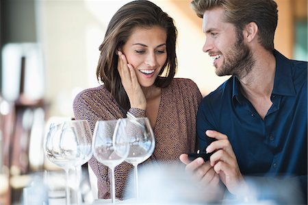 Man with engagement ring proposing his girlfriend in a restaurant Stock Photo - Premium Royalty-Free, Code: 6108-06905167