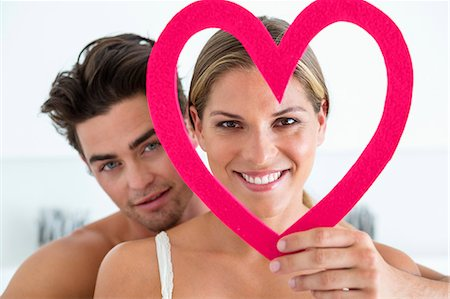 Couple with a heart shape object Stock Photo - Premium Royalty-Free, Code: 6108-06905165