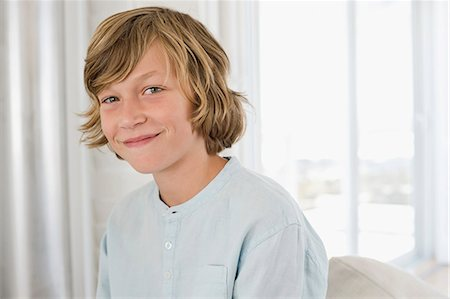 Portrait of a boy smiling Stock Photo - Premium Royalty-Free, Code: 6108-06905250