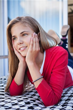 preteen touch - Girl lying on the bed and day dreaming Stock Photo - Premium Royalty-Free, Code: 6108-06905254
