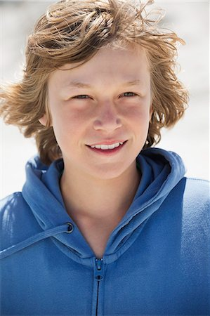 Portrait of a boy smiling on the beach Stock Photo - Premium Royalty-Free, Code: 6108-06905209