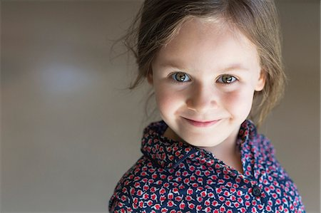 Portrait of a girl smiling Stock Photo - Premium Royalty-Free, Code: 6108-06905307