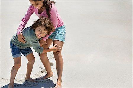 Children playing on the beach Stock Photo - Premium Royalty-Free, Code: 6108-06905327