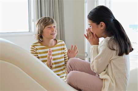 preteen long hair - Brother and his sister playing Stock Photo - Premium Royalty-Free, Code: 6108-06905333
