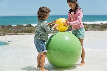 Children playing on the beach Stock Photo - Premium Royalty-Free, Code: 6108-06905335