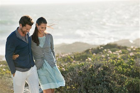 Couple walking on the beach Stock Photo - Premium Royalty-Free, Code: 6108-06905443