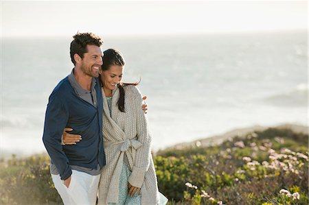 Couple walking on the beach Stock Photo - Premium Royalty-Free, Code: 6108-06905456