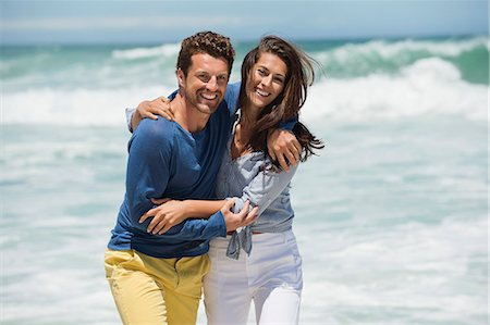 enjoying - Couple enjoying on the beach Stock Photo - Premium Royalty-Free, Code: 6108-06905459