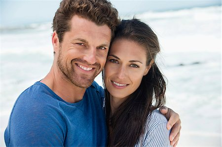 Close-up of a happy couple on the beach Stock Photo - Premium Royalty-Free, Code: 6108-06905460